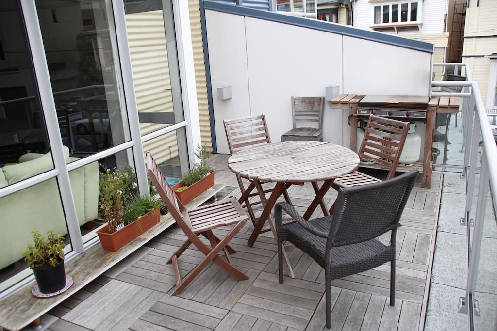 Large deck with a BBQ.