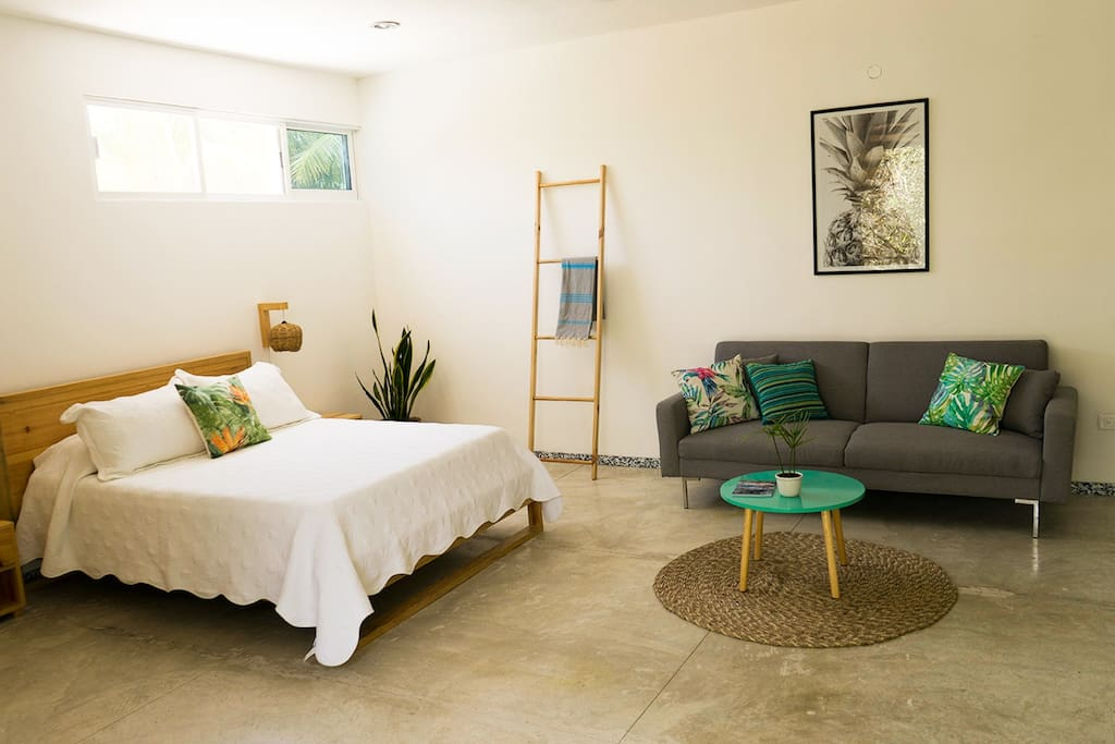 The studio includes a queen bed and a futon.