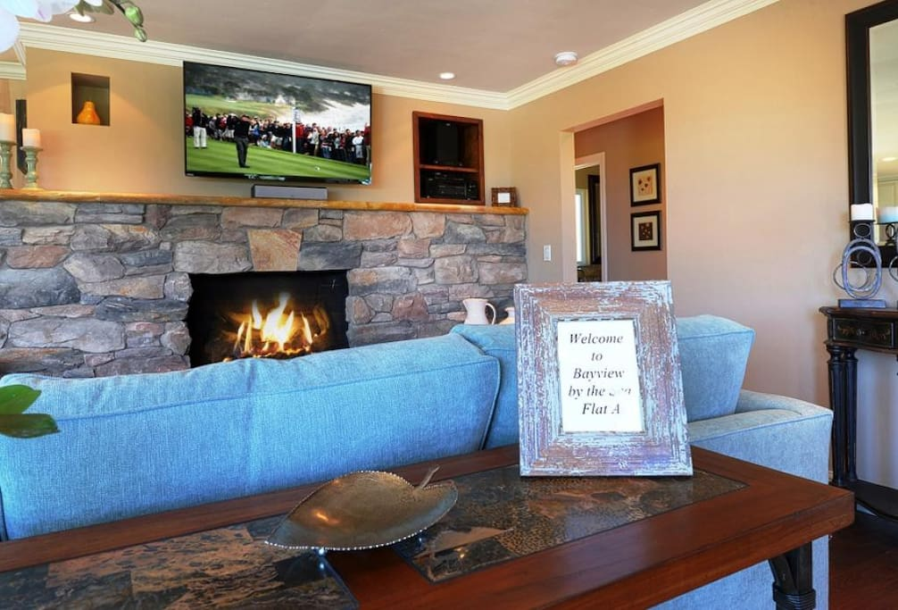 """Great Room has Comfortable Seating with a Gas Fireplace and 50"""" HDTV."""