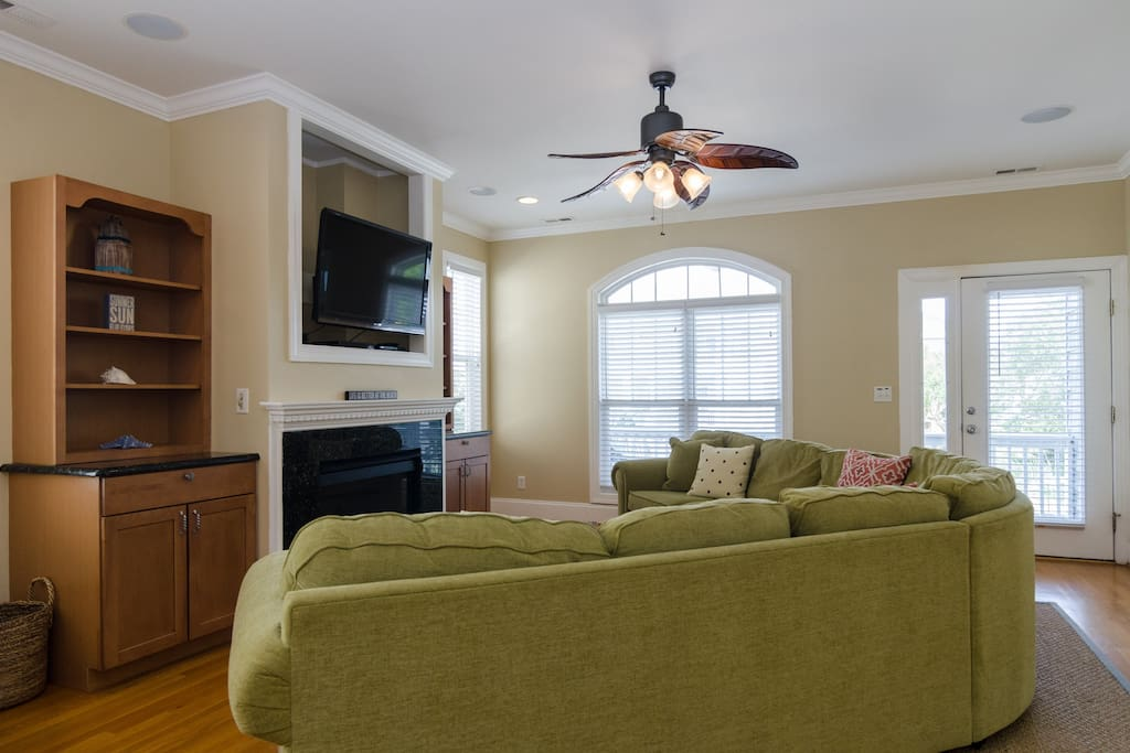Living room with small deck area.