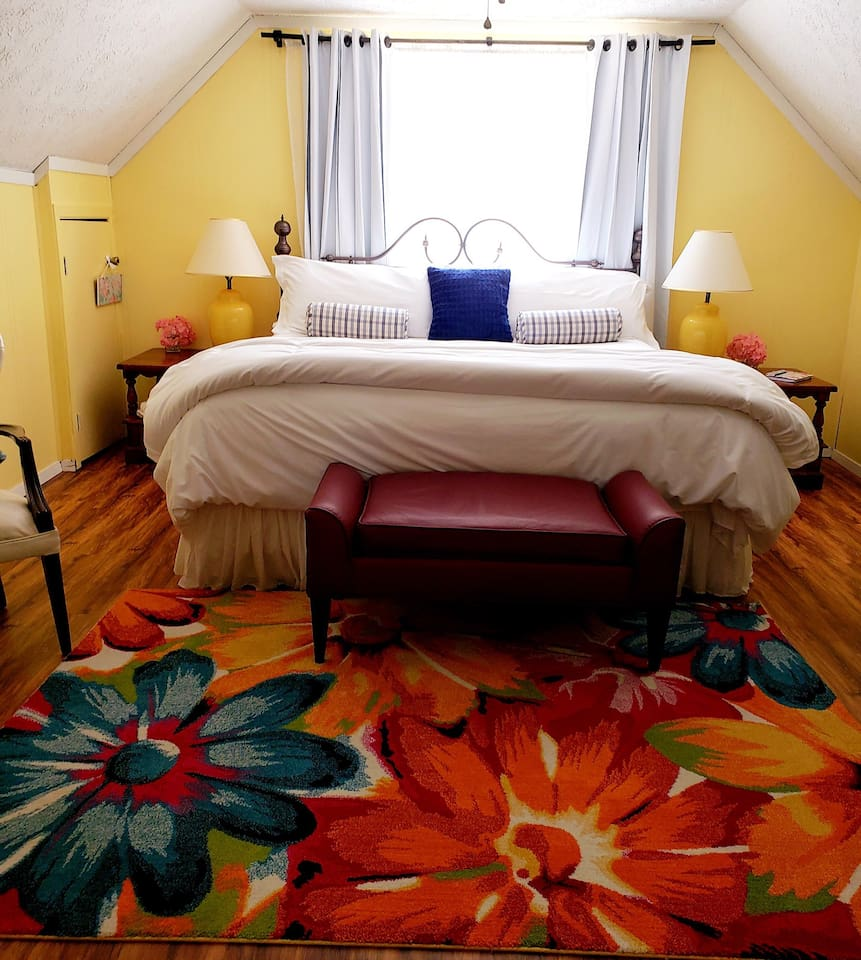 Our king room: clean, classic farm style with elbow room