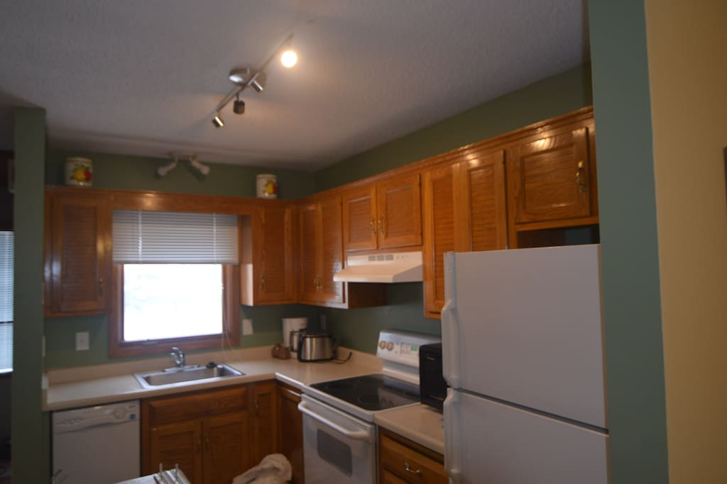 Kitchen, stocked with essentials, cooking utensils, and coffee provided