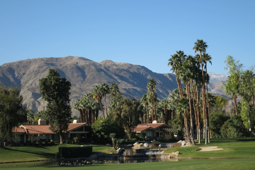 wide fairway with mountain and water feature