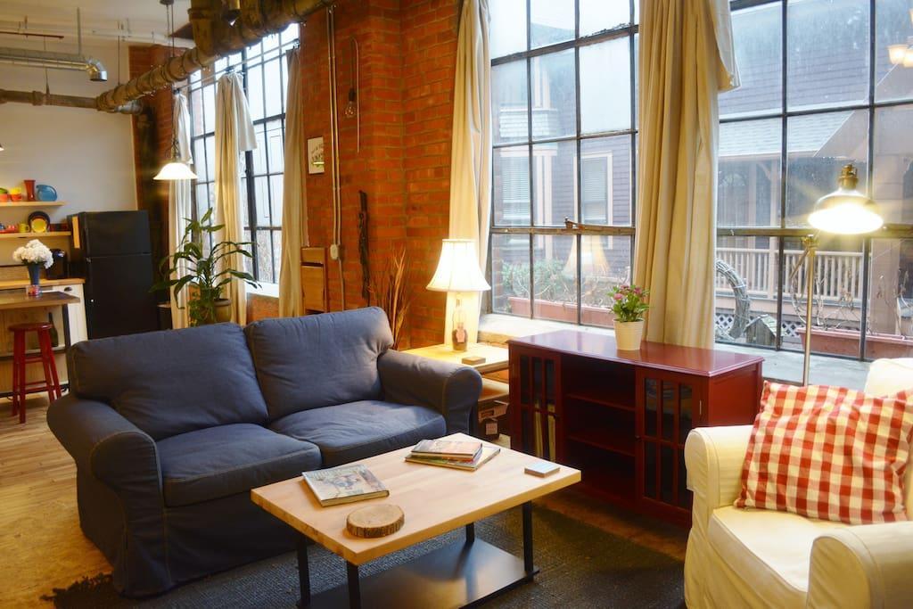 Large warehouse windows bring in an abundance of natural light.