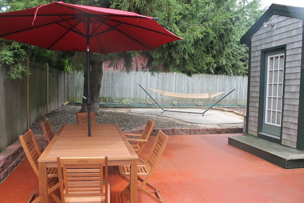 Full patio for your use, with hammock & grill, and outdoor shower