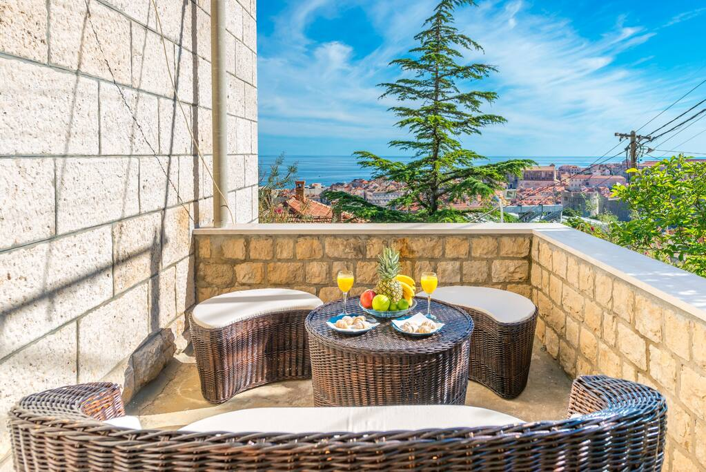 Welcome to Villa Magnolia, in this two-bedroom apartment our guests can relax on spacious terrace sourrounded with mediterranean garden equipped with dining table and lounge furniture boosting spectacular sea view over Adriatic Sea, Lokrum Island and UNESCO protected Dubrovnik Old Town.