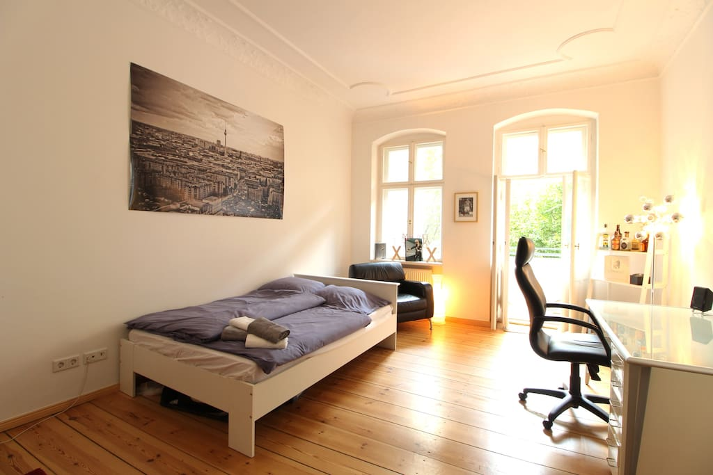 The old building apartment has high walls, stucco and large windows.