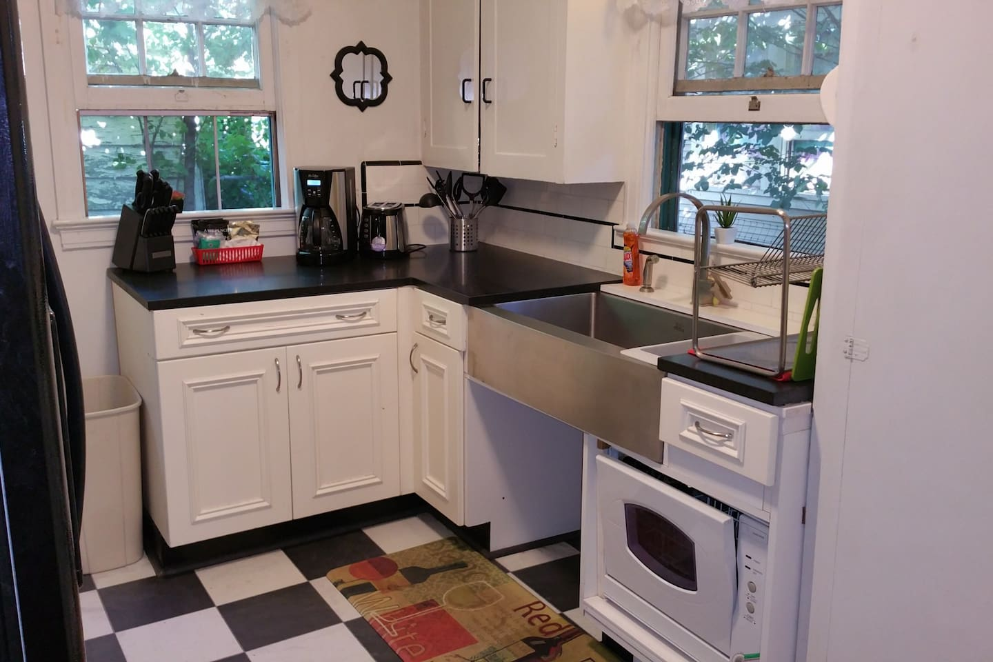 Honed Granite Countertops with $1100 Stainless Steel Farmsink in this updated kitchen. Open area underneath sink was designed as a pet feeding station. Pico Remote control at the back door runs the Welcome Home Scene, Relax Scene and All Off Scene. Never walk in the dark in this Townhome!