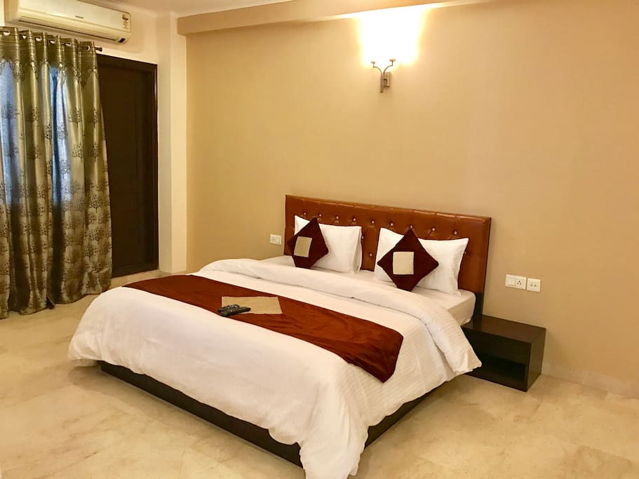 "King Bed with premium mattress and 32"" Flat screen TV with Tata Sky HD plus attached Bathroom"