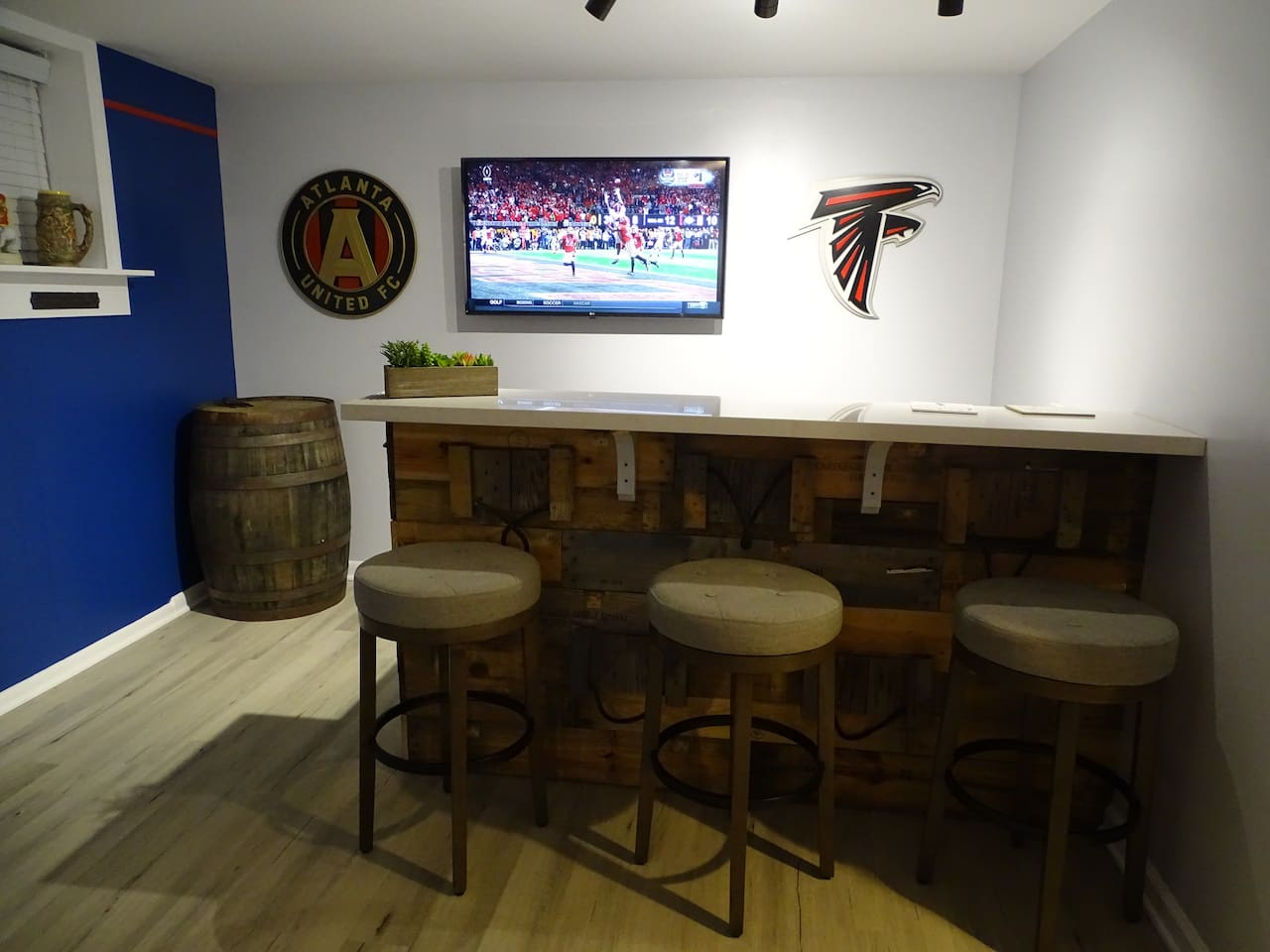 Brand new mancave with bar, custom logos of Atlanta teams, and TVs loaded with entertainment and sports