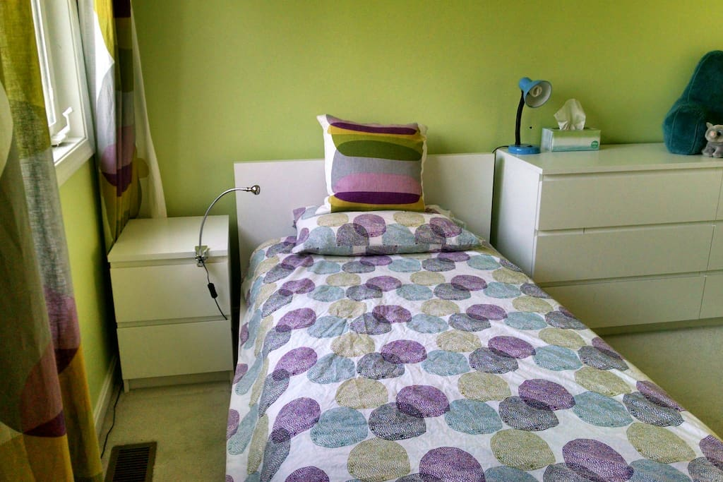 Twin bed with closet storage, night stand, drawers