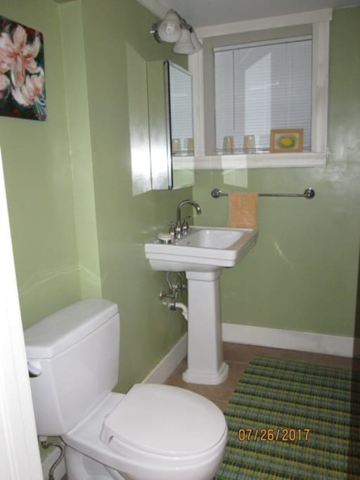 Private Bathroom with shower across hallway from bedroom.