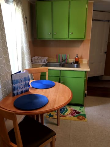 Kitchen's eat-in table can seat 4 when leaves extended.  Spare chairs available upon request.