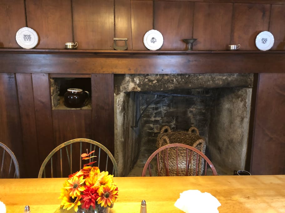 The house is built around this massive chimney, which has paneling decorating portions of it. Fireplaces not functional.