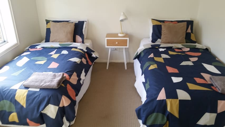 Bedroom 3.  Newly added brand-new single beds as of November 2018. The newest addition to our home in time for Christmas!