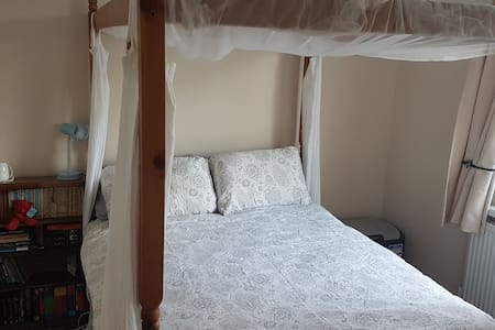 Lovely double bedroom with four poster bed