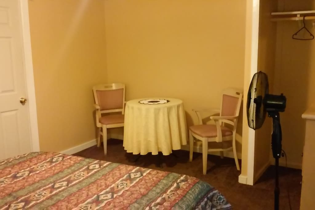 small table and chairs in room