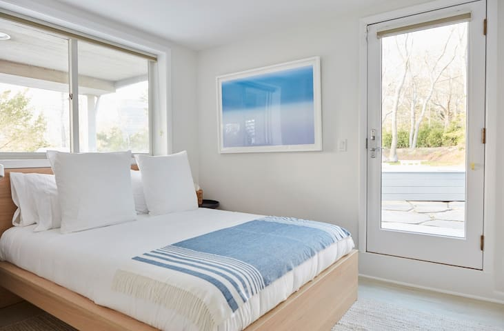 Queen guest bedroom #5 downstairs with 55in smart tv and views of the water! + access to pool/spa deck.