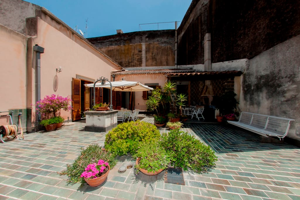 Sicilian terrace of the old noble residences. At the center of the terrace he was used to organize lunch and dinner. In Sicily thanks to the sun, everything is possible!