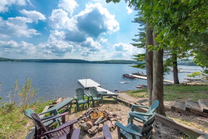 Waterfront home with a pool table, hot tub & even a private dock!