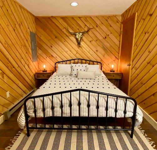 Bedroom with queen bed on first floor. Bedroom #1.