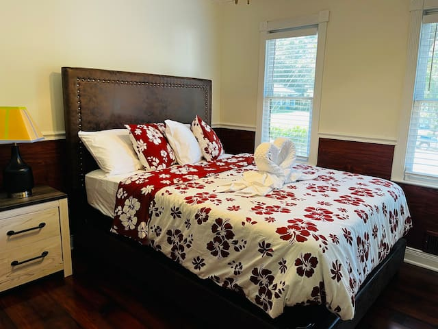 2nd Bedroom - Upholstered headboard, Queen size bed with night stand and table lamp.