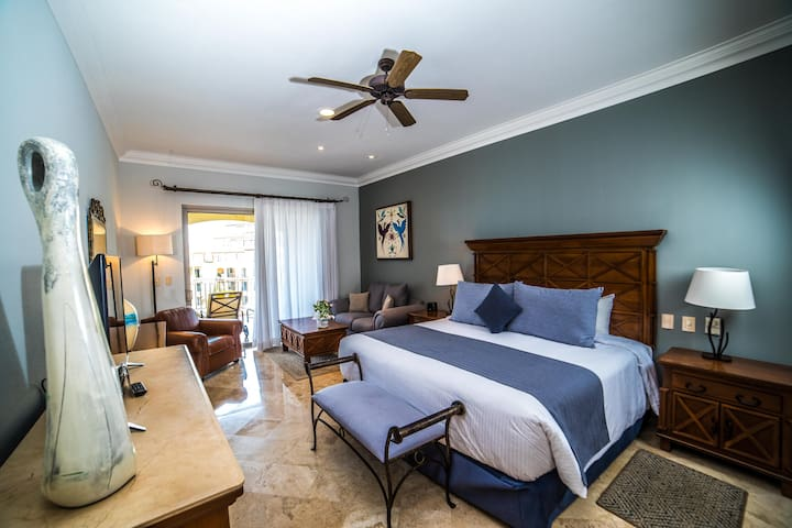 Luxurious king bed in master bedroom with ocean views, two separate seating areas and a 60 inch HD TV. All living spaces were redecorated in 2019.