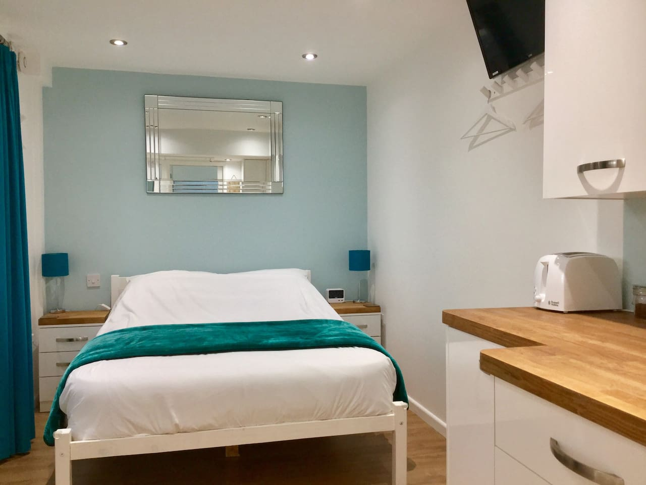 View from en-suite showing bed and kitchenette