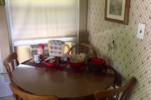 Kitchen table and 4 chairs in the kitchen area. Coffee, popcorn and water are provided for Carriage House guests.
