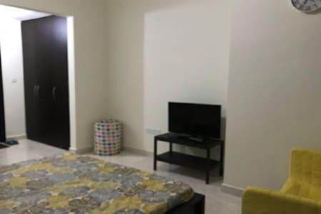 Master Bedroom with Parking for Rent in Al Reem