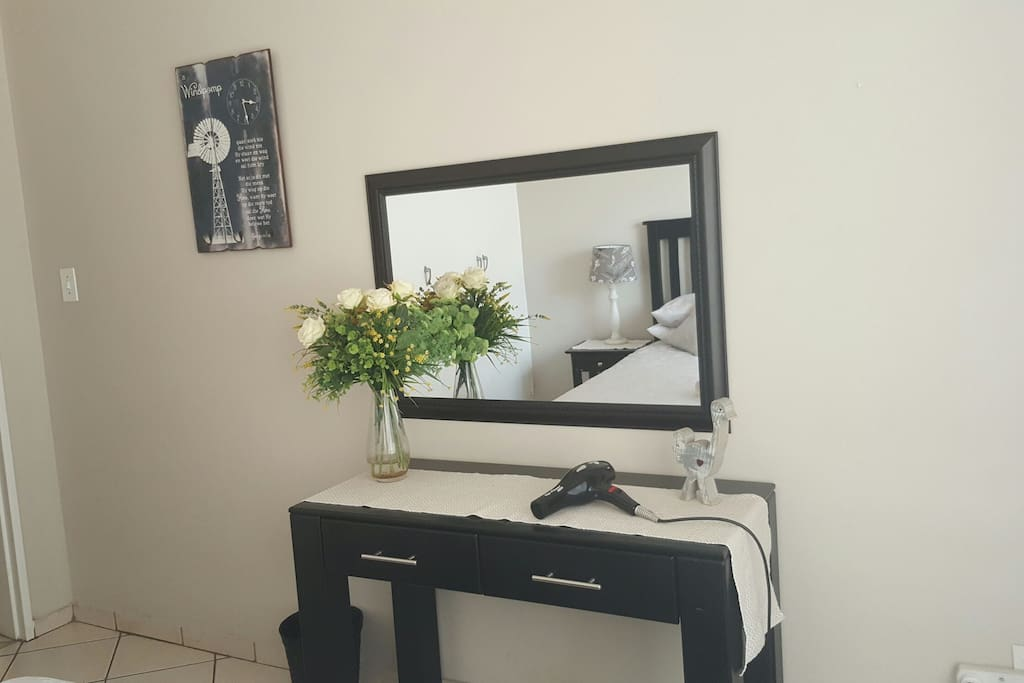 Table with mirror. Hairdryer. Can be used as a table to work on.