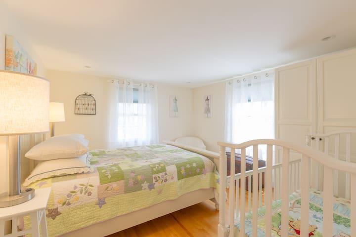 Bed #3: Second floor queen bedroom with baby crib