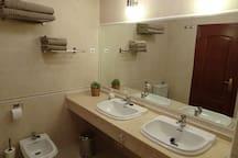 En-suite bathroom for bedroom 1 with bath and shower