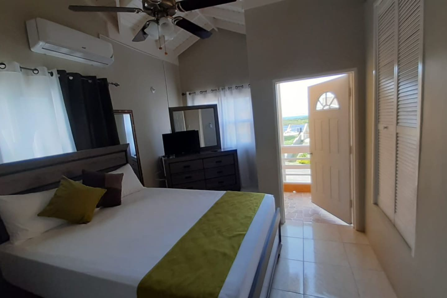 Bedroom on upper floor with balcony, partial seaview and private bathroom
