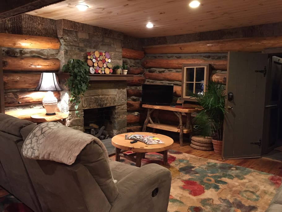 This is the main living area with reclining sofas, a dining table that seats six, Roku TV and Wifi. There is also a 1/2 bath and daybed on this floor. Lots of natural light and views of the outdoors.