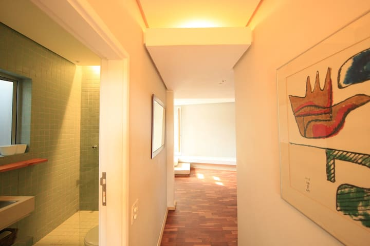 separate bathroom fully equipped with jacuzzi bath, shower, toilet and bidet
