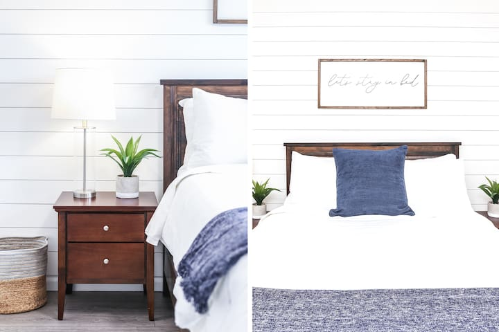 The main bedroom offers a plush queen sized bed, walk through closet and the main bathroom is attached.   Enjoy room darkening shades on the large window to mute the morning light.