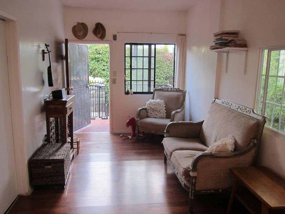 living room with open door to the patio