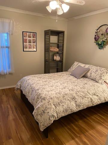 Second bedroom with a full size bed, bathroom is just next door. Sleep comfortably under a down comforter.