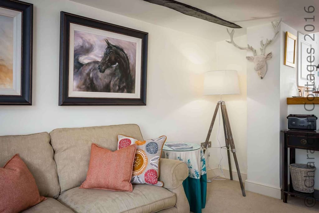 Lovely furnishings complement the traditional character of the property