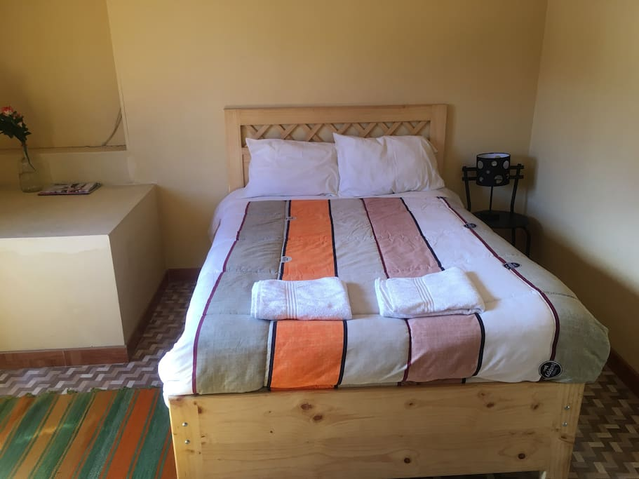 Main room with a double bed.