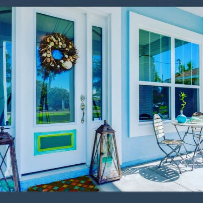 Front porch is a cozy space for socializing, resting, reading or just enjoying the ocean breeze.