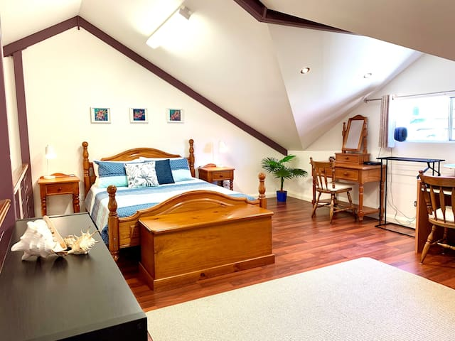 Upstairs Master Bedroom.  Wooden floors.  Open and Spacious