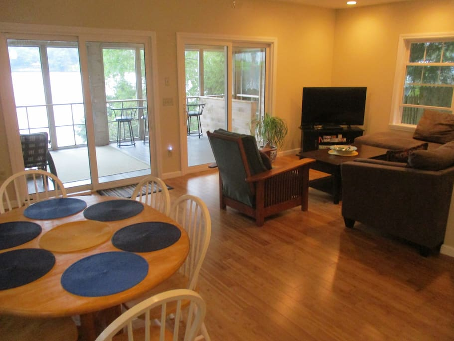 Open floor plan for the kitchen, dining table, living room and porch.