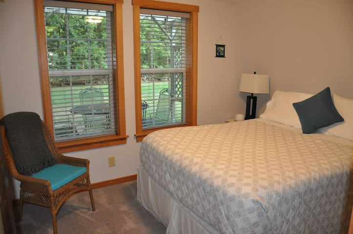 The bedroom on the main floor has a  queen sized bed.