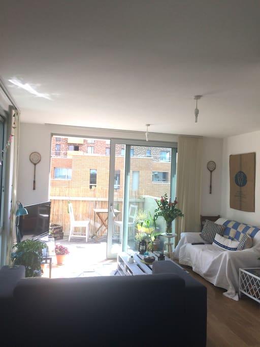 Bright, sunny balcony and living room!