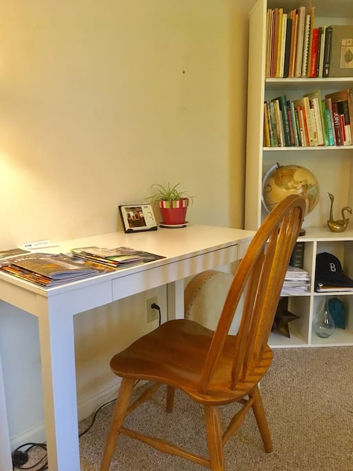 Writing and computer desk, plus pamphlets for Ithaca & the Finger Lakes