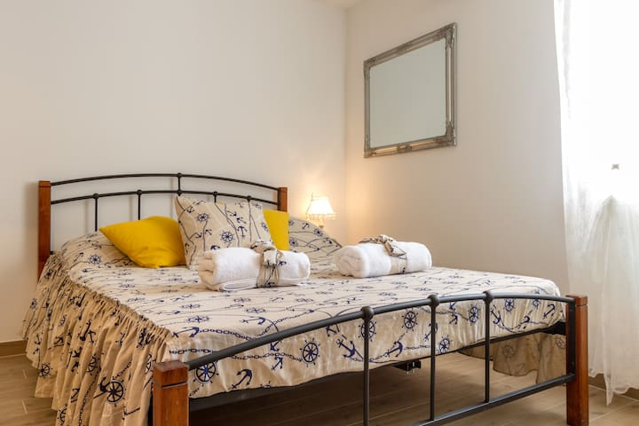 Double bed with lamp