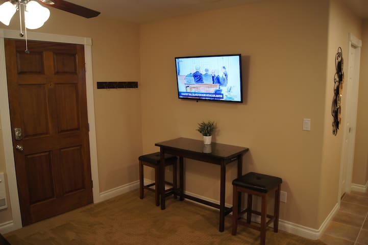 Dining Area with Large High Definition Smart TV.