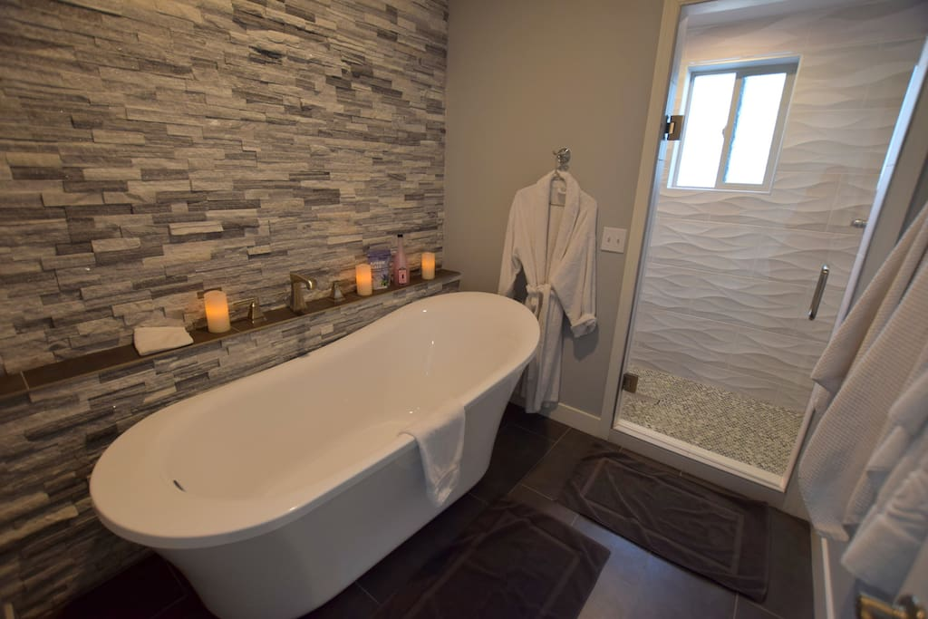 Light the candles and take a bubble bath. We provide shampoo, conditioner, bath wash, bubbles for the bath and towels. Or take a shower with shower head in front and above you.  Enjoy the spa!
